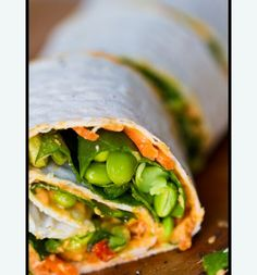 hummus wraps - with edamame, baby spinach, shredded carrots and a splash of olive oil or lemon juice.  You could do so many yummy variations of this    2-3 Tbsp Roasted Red Pepper Spread  handful of shredded carrots  handful of baby spinach  splash of lemon juice/olive oil  fresh ground pepper  edamame soy beans  avocado slices