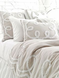 may be too frilly for ross? would be super luxe if we did a tonal, neutral bed..
