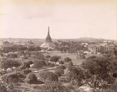 "Sule Pagoda taken by the German photograph Philip Kliers in the 1890s. The photograph is taken from Barr Street, the old town hall is to the right and the Shwedagon in the distance. The cast-iron bandstand in the middle of the park (then ""Fytche Park"") was a gift of a local Jewish businessman Mordecai Isaac Cohen."