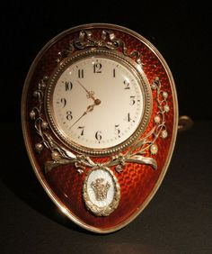 Faberge Lily of the Valley clock, gilt trim and red guilloche enamel