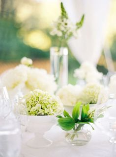 green centerpieces in white bowls