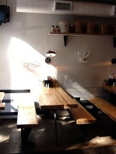 Steal This Look: Mile End Delicatessen in Brooklyn : Remodelista. Bowling alley lane wood for tables and counters.