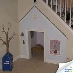 Cute use of space under the basement stairs