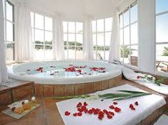 ((Minus the rose petals.)) HUGE TUB, Music that makes colors dance. Jacuzzi Bathtub, Corner Bathtub, Bathroom Spa, White Bathroom, Relaxing Bath, Beautiful Bathrooms, Luxury Life, Home Collections, Nooks