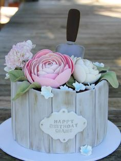 Gardening Themed Cake featured Gum-paste Ranunculus,Carnations & Country Blossoms by Coco Jo