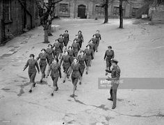 NAAFI women at a marching drill in preparation for the 'Wings For Victory' procession.