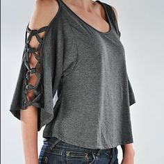 Cute cut out open should grey top Small.  Fits like Xs if you you want it lose fitting.  Never worn. Charcoal grey. Tops