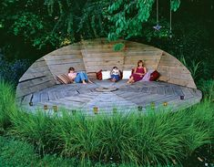 """""""The oak boards of this oversize """"deck chair"""" are smooth enough for bare feet, and the angle of its back was carefully set to be """"relaxed but not too relaxed."""" Such raised platforms can be hidden by plantings such as the Stipa arundinacea used here.    Matthews' daughters (pictured with Matthews) and their pals often turn this deck into a stage, performing for audiences (parents) seated in the grass below."""""""
