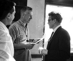 Director Nick Ray and James Dean on the set of Rebel Without a...