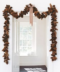 Pinecone Swag  A stroll through the woods to gather pinecones doesn't fit into your schedule? Buy them either cinnamon fragranced in a bag or prestrung to make an easy swag. Tie a big bow in the middle so you can center it perfectly over the doorway, then tack the swag up with nails.  too much cinnamon, intersperse them with unscented ones.