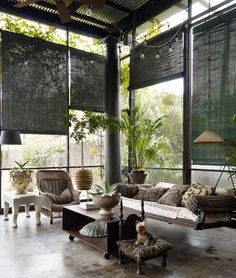 indoor outdoor room: matchstick blinds, hanging bench, lots of pillows Photographer : William Waldron
