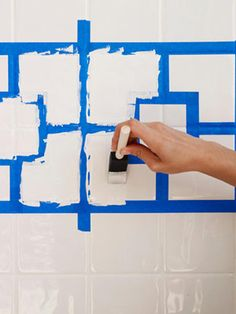 How to Paint Ceramic Tile - DIY Painting Bathroom Tile - Redbook Sounds like it'd be a lot of work, but still less than re-tiling and definitely cheaper! Paint Backsplash, Beadboard Backsplash, Herringbone Backsplash, Stove Backsplash, Easy Backsplash, Quartz Backsplash, Black Backsplash, Hexagon Backsplash, Painting Bathroom Tiles