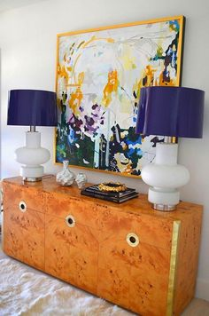 beautiful table scape - art, burl console, navy lacquered shades