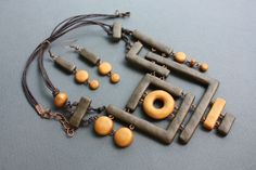 Olga Permyakova Lovely polymer clay composition                http://permyakova.net/wp-content/gallery/necklace/dogon.jpg