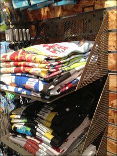 Cantilever Perforated Metal T-Shirt Shelves Redux Vendor Displays, Craft Booth Displays, Hat Display, Merchandising Displays, Display Ideas, T Shirt Storage, Clothing Store Displays, Retail Shelving, Metal T Shirts