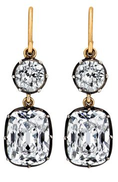 This fiery pair of diamond drop earrings, designed by Steven Fox, is destined to become a family heirloom. Two magnificent cushion cut diamonds totaling 6.04 carats are suspended by an additional two cushion cut diamonds totaling 1.54 carats both set in an oxidized silver and gold frame.