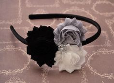 A personal favorite from my Etsy shop https://www.etsy.com/listing/230530818/black-flowered-headband-black-grey-white