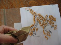 Dinosaur Fossil cake- pipe melted baking chips onto wax paper using a printed skeleton as a template.