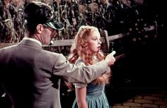Judy Garland in a blond wig for a screen test for The Wizard of Oz. The wig, of course, was not used in the actual filming.