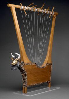 "Bull-headed harp (lyre) w/ inlaid sound box, from the tomb of Pu-abi, Royal Cemetery, Ur, Iraq, Sumerian, ca. 2600-2400 BCE. Wood, gold, lapus lazuli, red limestone, shell; 3'8"" high."