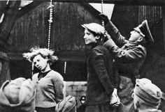 Execution the Soviet underground fighters in Minsk - This is the first public execution in the occupied territories, on the day in Minsk on the arch of the yeast plant hanged 12 Soviet members of the underground who helped the wounded Red Army to escape from captivity. In the photo – the time of Vladimir Shcherbatsevich to be hanged. Vladimir has an age of 16 years. Left – hung 17-year-old Maria Bruskin.