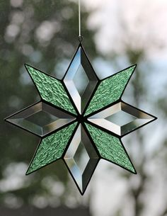 Stained glass and bevel quilt star by Barbara's Glassworks.
