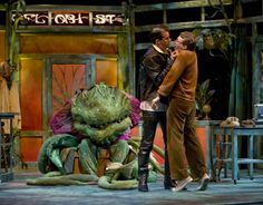 Rod Thomas and Jonathan Lee Cunningham with Audrey II in the monster musical hit LITTLE SHOP OF HORRORS at Theatre at the Center - www.theatreatthecenter.com
