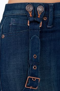 """We'll spare you the suspense and get right to the good stuff: the Dittos Santana Dark Wash High Rise Skinny Suspender Jeans! Straight from the seventies, these skintight jeans have a little light fading over their dark blue wash, plus a five-pocket cut with a real high-waisted fit. Detachable suspender straps have copper buckles with five convenient adjustments. Leather logo patch at back. Unlined. Model is 5'8"""" and is wearing a size 26. 66% Cotton, 33% Polyester, 1% Spandex. Machine Wash…"""