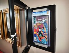 The World's First Locking Comic Book Display System with removable frames and mounting brackets for all sized traditional and graded comic books.  www.comiclock.com