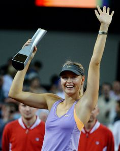 Russia's Maria Sharapova celebrates with her trophy after defeating Serbia's Ana Ivanovic with and in their final match at the Porsche tennis Grand Prix in Stuttgart, Germany, Sunday, April (AP) Maria Sarapova, Tennis News, Stuttgart Germany, Ana Ivanovic, Tennis Players Female, Grand Prix, Cheerleading, Finals, Porsche