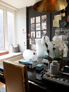 office, black walls, gold accents, inspiration board