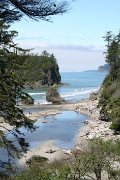 "Ruby Beach, Washington:The black sand, cool water, smooth rocks, and huge ""rock mountains"" with tidal pools...it was truly other-worldly!"