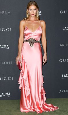 Rsie Huntington-Whiteley in a pink silk satin spaghetti strap Gucci gown with a sequin tiger belt at the LACMA Art + Film Gala in L.A.