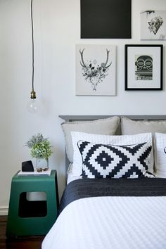Monochrome bedroom with green accent
