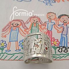 """A twist on our sterling silver """"family ring"""": birthstones included for each family member! We happily work with clients to create their unique vision."""
