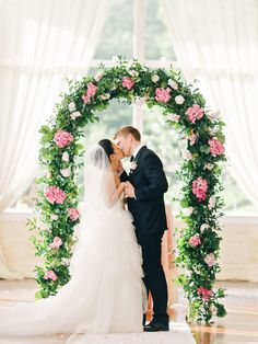Wedding Arch With Greenery and Pink Hydrangeas | Photo: Amy Arrington Photography |