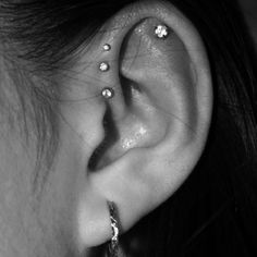 Triple helix, cartilage, and lobe. All its missing is like two more piercings on the lobe