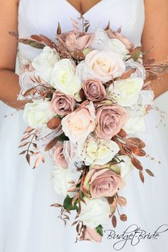 This stunning brides bouquet is a cascading bouquet made with blush pink, ivory and rose gold colored roses accented with lace, rose gold foliage and rose gold pearl sprays. This bouquet is approx 10 inches wide and about 18 inches long. Spring Wedding Bouquets, Blush Wedding Flowers, Dusty Rose Wedding, Pink And Gold Wedding, Wedding Flower Arrangements, Blush Roses, Bridal Flowers, Gold Flowers, Cascading Flowers