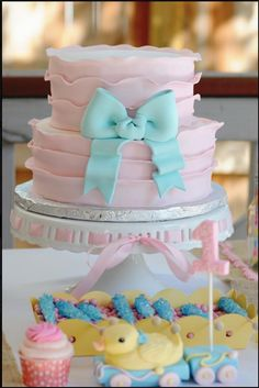 baby shower cake idea White frosting, tan bow / burlap bow