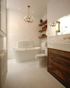 Simple but beautiful bathroom with timber shelving and clean lines