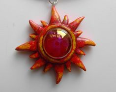 Sun pendant necklace with glass pebble hand sculpted from Fimo polymer clay red/yellow tribal hippy summer jewellery/jewelry