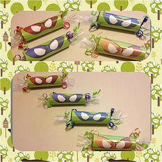Teenage mutant ninja turtle party .... TMNT candy rolls... Inspired by the green team these rolls are stuffed with a variety of candy. They are about 5 inches long an 2 inches wide. They serve as an alternative to the traditional goody bag or as additional party favor. 8 rolls for $20. Created by Nubian's Nook. Email me at mailto:nubiansnoo... for invoice via paypal or visit www.etsy.com/...
