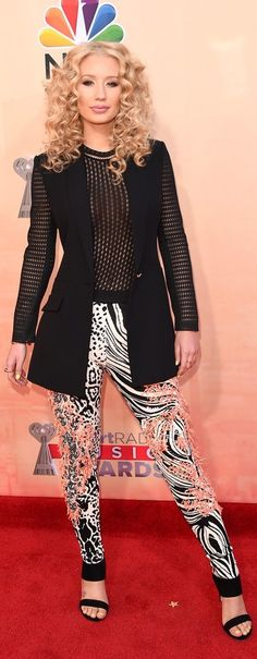 Iggy Azalea in printed mixed-media pants, a mesh long sleeve shirt, and tailored vest at the iHeartRadio Awards.