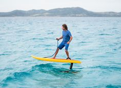the jetfoiler eFoil fuses a motorized surfboard with a hydrofoil, creating a board that hovers above the water's surface.