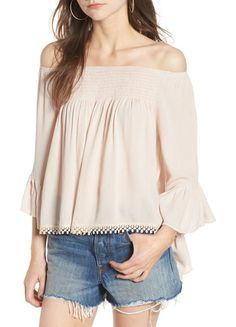 anne off the shoulder blouse by Raga. A lace-trimmed hem and beautifully breezy bell sleeves add to the romance of this softly crinkled, blush-hued top with a sunshine-friendly neckline.  #raga