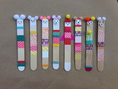 i made these with popsicle sticks, wash tape & pom-poms. we use them as bookmarks and christmas ornaments.