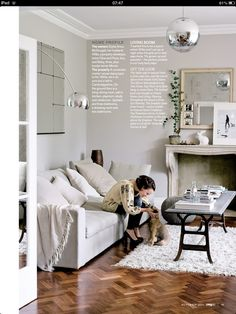 Walls in cornforth white by farrow and ball, mirror behind sofa Nicole Farhi