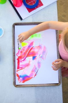 Scrape painting with a credit card. Easy craft with cool results!