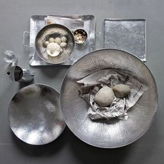 Hammered Silver serving trays from West Elm  I have the small rectangular tray and small dip bowl and use them for cosmetics and hair ties, I want all the others, too!