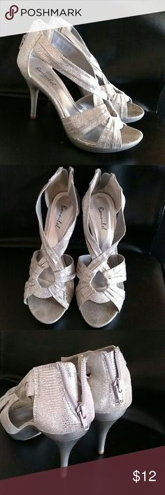 """Silver heels Bonnibel brand  - damage underneath the shoe as shown - silver (shiny) material - worn twice - 8.5 in U.S woman's (I'm normally an 8 for reference) - Zipper closure behind heel - 2.5"""" heel Bonnibel Shoes Heels"""